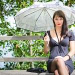 Girl under the umbrella — Stock Photo #4383918