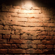 Stock Photo: Lighted by brick wall