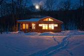 Luminous windows night at home — Stock Photo