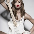 Stock Photo: Sexy fashion girl with guitar