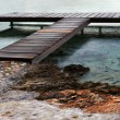 T-shaped wooden pier - Stock Photo