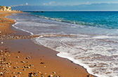 Long and inviting sandy beach in the Mediterranean — Stock Photo