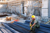 Construction worker resting on steel bars — Stock Photo