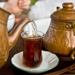 Drinking Traditional Turkish Tea With Friends - Stock Photo