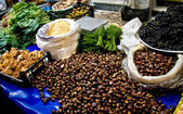 Fresh Organic Chestnuts and Other Goods At A Street Market In Is — Stock Photo