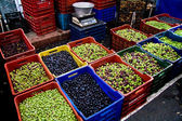 Fresh Organic Different Types Of Olives At A Street Market In Is — Stock Photo