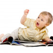 Stock Photo: The little boy reads magazine