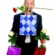 Royalty-Free Stock Photo: Young Man With Rose and shopping bag