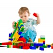 Cute little baby boy with colorful building block — Stock Photo #4810420