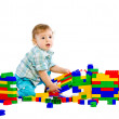 Cute little baby boy with colorful building block — Stock Photo #4810457