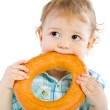 Little baby boy holding a bagel — Stock Photo #4810781