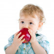 Beautiful baby boy eats red apple. — Stock Photo #4810811