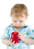 Beautiful baby boy eats red apple. — Stock Photo