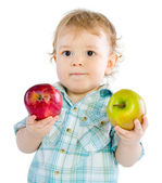 Beautiful baby boy play with green and red apples. — Stock Photo