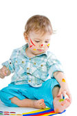 Beautiful baby covered in bright paint — Stock Photo