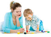 Young mum draws with the son paints — Stock Photo