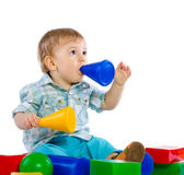Cute little baby boy with colorful building block — Stock Photo