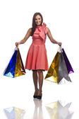 Pretty young womsn with bags of purchases — Stock Photo