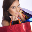 Stock Photo: Pretty young womwith bags of purchases