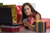 Young pretty women is buying in internet — Stock Photo
