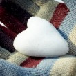 Snow heart in woman hands — Stock Photo