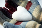 Snow heart in woman hands — Foto Stock