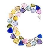 Gemstones alphabet, letter C. Isolated on white background. — Stock Photo