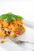 Serving of heirloom tomato bread pudding — Stock Photo