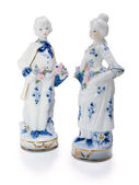 Porcelain figurines of young men and women.Love — Stock Photo
