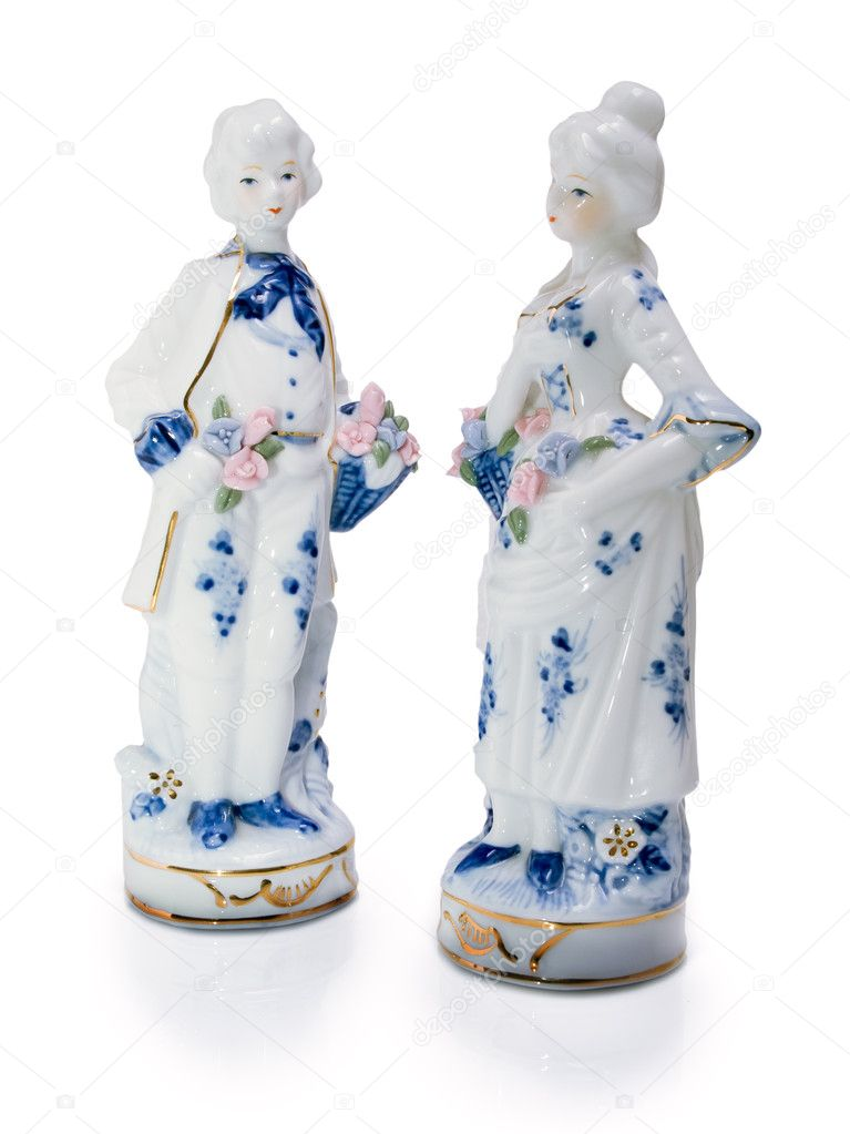Porcelain figurines of young men and women arc turned to each other. — Stock Photo #4768920