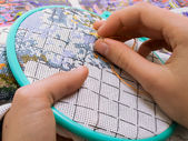 Embroidery in the children's hands — Stock Photo