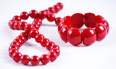 Red beads and bracelet — Stock Photo