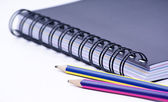 Notebook with a colored pencils — Stock Photo