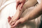 Man Massaging Male Foot — Stock Photo