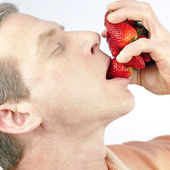 Eating Strawberries — Stock Photo