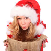 Amazed Miss Santa with Christmas Bag — Stock Photo