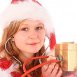 Miss Santa is Giving a Smile While Sounding a Golden Gift Box — Stock Photo