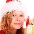 Royalty-Free Stock Photo: Miss Santa is Opening a Golden Gift Box