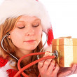 Miss Santa is Sounding a Golden Gift Box — Stock Photo