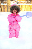 Girl in snowsuit standing in deep snow — Stock Photo
