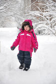 Cute toddler girl walking at beautiful winter day — Stock Photo