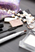 Decorative composition consisting of cosmetics and jewellery — Stock Photo
