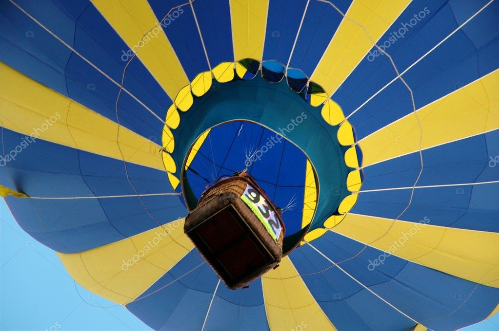 Hot air balloon with passenger size basket floating overhead. — Stock Photo #4242243