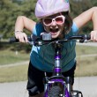 Girl Being Silly on a Bike — Stock Photo #4038899
