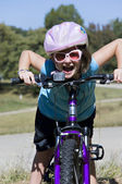 Girl Being Silly on a Bike — Stock Photo
