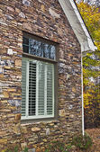 Window Shutters and Stone Facade — Stock Photo