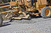 Spreading Gravel on a Road — Stock Photo