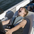 Silly Boy Driving a Boat — Stock Photo