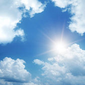 Clouds and sun on sky — Stock Photo