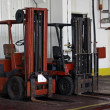 Stock Photo: Two forklifts in warehouse